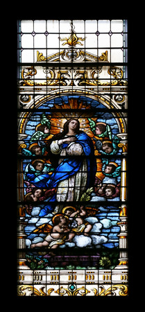assumption: Assumption of the Virgin Mary, stained glass window in the Basilica of the Sacred Heart of Jesus in Zagreb, Croatia Editorial
