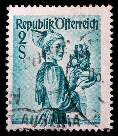 upper austria: Stamp printed in the Austria shows Woman from Upper Austria, Regional Costume, circa 1948