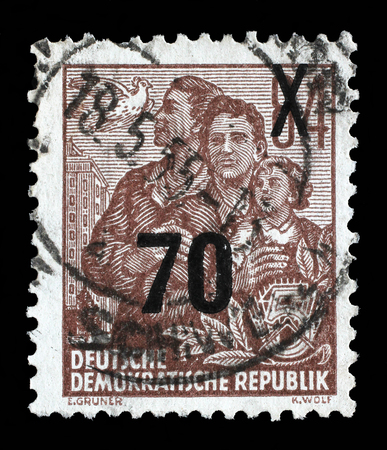 gdr: Stamp printed in GDR, shows a family, series Five-year plan, circa 1955