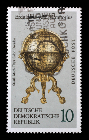 east germany: Stamp printed in the DDR East Germany shows vintage globe, one stamp from series devoted State saloon of physics in Dresden, circa 1972