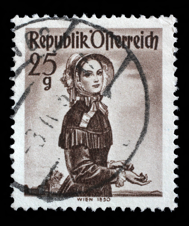 stempeln: Stamp printed in Austria from the Provincial Costumes issue shows a woman from Vienna 1850, circa 1948.