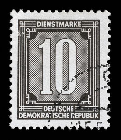 numeric: Stamp printed in GDR shows numeric value, circa 1956. Editorial