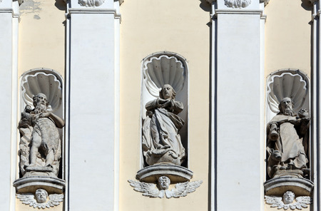 mystic place: Saint Gregory the Great, Jesus Christ and Saint Jerome on the portal of parish Church of the Immaculate Conception of the Virgin Mary in Lepoglava, Croatia