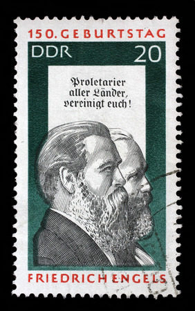 theorist: Stamp printed in GDR shows Friedrich Engels and Karl Marx, Social Scientist, Political Theorist and Marxist, circa 1970