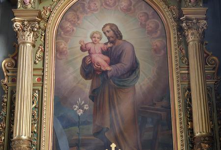 altarpiece: Saint Joseph holding child Jesus altarpiece in the Basilica of the Sacred Heart of Jesus in Zagreb, Croatia