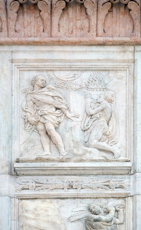 sacrifices: BOLOGNA, ITALY - JUNE 04: Cain and Abel sacrifices, Genesis relief on portal of Saint Petronius Basilica in Bologna, Italy, on June 04, 2015 Editorial
