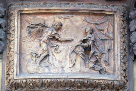 angel gabriel: Relief of Annunciation scene on the house facade in Bologna, Italy