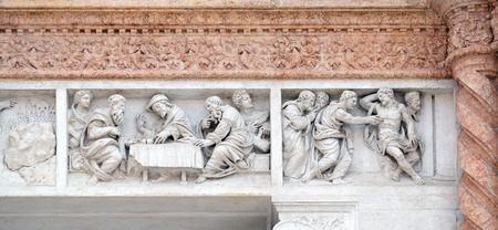 disciples: Supper at Emmaus left and Doubting Thomas right by Zaccaria da Volterra, door of San Petronio Basilica in Bologna, Italy