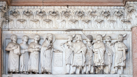 bass relief: The right portal of the Cathedral of St Martin in Lucca. Lunette dedicated to the life of Saint Regulus, Lucca, Italy