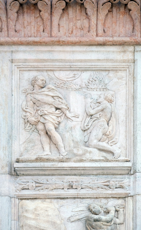 sacrifices: Cain and Abel sacrifices, Genesis relief on portal of Saint Petronius Basilica in Bologna, Italy