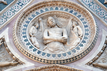 shroud: Wrapping Christ in his shroud, Portal on the side-wall of Cattedrale di Santa Maria del Fiore (Cathedral of Saint Mary of the Flower), Florence, Italy Stock Photo