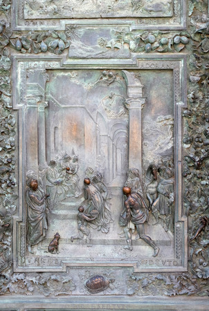 adoration: Adoration of the Magi, detail of the bronze door to the left of the Cathedral St. Mary of the Assumption in Pisa, Italy
