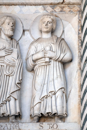 thomas stone: Bas-relief representing the Saint Thomas the Apostle, Cathedral of S.Martino in Lucca, Italy Stock Photo