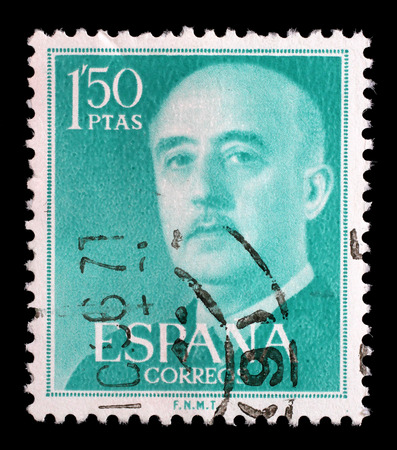 spaniard: Stamp printed in Spain shows a portrait of Francisco Franco, circa 1955.