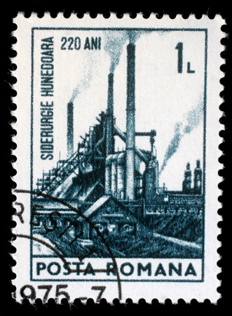 steel works: Stamp printed in Romania shows 220th anniversary of Hunedoara Iron and Steel works, circa 1974.
