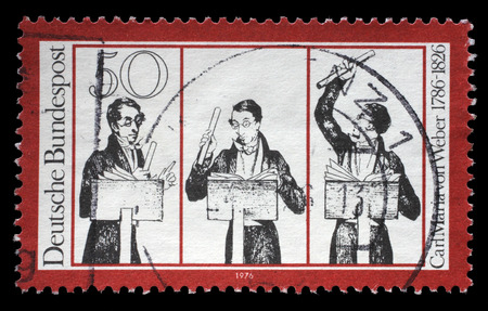 weber: Stamp printed in German Democratic Republic (East Germany) honoring Carl Maria von Weber, shows musicians, circa 1976