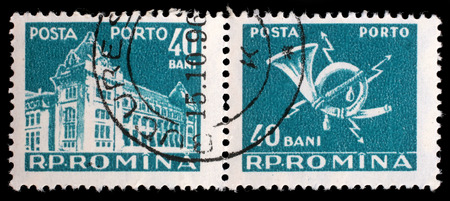 posthorn: Stamp printed in Romania shows Central Post Office building (National museum of Romanian history now), circa 1967. Editorial