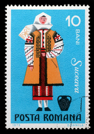 bani: Stamp printed in Romania shows image of a Suceava woman, from the regional costumes series, circa 1973 Editorial