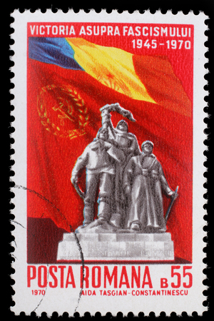 fascism: Stamp printed in Romania shows Victory Monument and flags of Romania and USSR  25 Years - Victory Over Fascism, circa 1970. Editorial