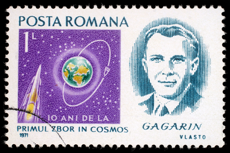 yuri: Stamp printed in Romania shows portrait of Yuri Gagarin with inscription and name of series Scientific Anniversaries - 10 anniversary of first manned space flight, circa 1971
