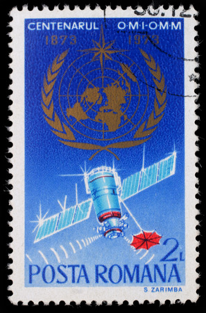 meteorological: Stamp printed in Romania shows The 100th Anniversary of the World Meteorological Organization, circa 1973.