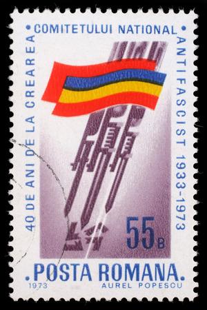 stabbing: Stamp printed by Romania, shows Romanian flag, Bayonets stabbing Swastika, circa 1973.