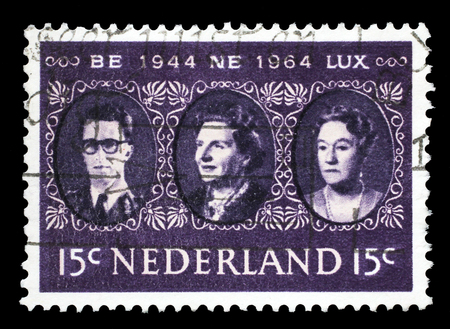 juliana: Stamp printed in the Netherlands shows King Baudouin, Queen Juliana and Grand Duchess Charlotte, Benelux, circa 1964 Editorial