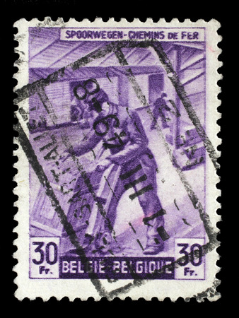 shipper: Stamp printed in Belgium shows Box-shipper from The Railway Company at Work issue, circa 1945.