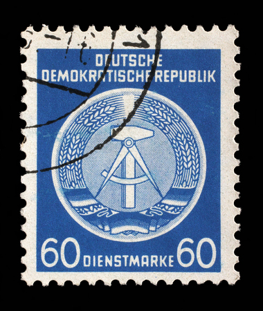 ddr: Stamp printed in GDR (German Democratic Republic - East Germany) shows DDR national coat of arms with inscription Service Stamp, series GDRs national coat of arms, circa 1952 Editorial