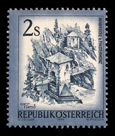 alt: Stamp printed in the Austria shows Inn Bridge, Alt Finstermunz, Tirol, circa 1974