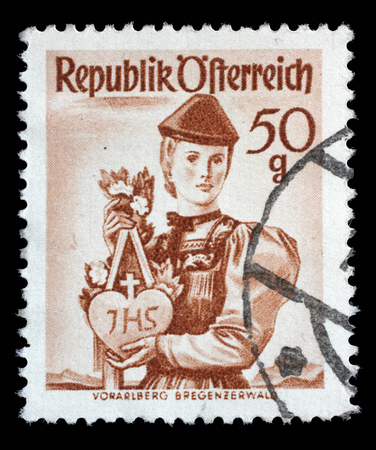 stempeln: Stamp printed in Austria from the Provincial Costumes issue shows a woman from Vorarlberg Bregenzerwald, circa 1948. Editorial