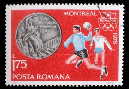 olympic rings: Stamp printed in Romania, shows Handball, and Olympic Rings, with inscription Montreal, 1976, circa 1976 Editorial