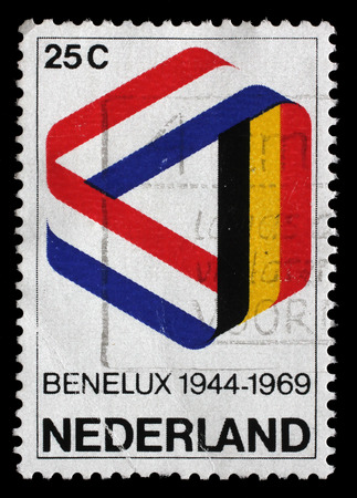 benelux: Stamp printed in the Netherlands shows Mobius Strip in Benelux Colors, 25th Anniversary of the Signing of the Customs Union, circa 1969