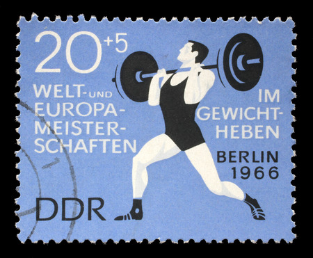weightlifter: Stamp printed in GDR (German Democratic Republic - East Germany) shows weightlifter, circa 1966 Editorial
