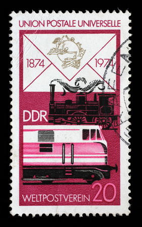centenary: Stamp printed in GDR shows Old Steam Locomotive and Modern Diesel, Centenary of the UPU, circa 1974