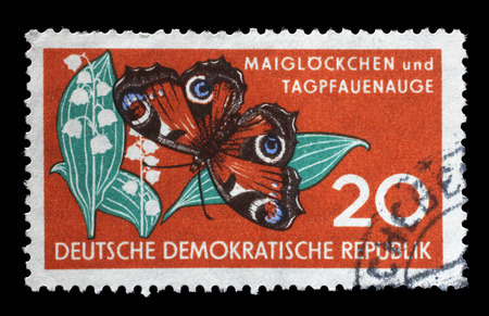 gdr: Stamp printed in GDR shows Lily of the Valley and Butterfly, Nature, circa 1959