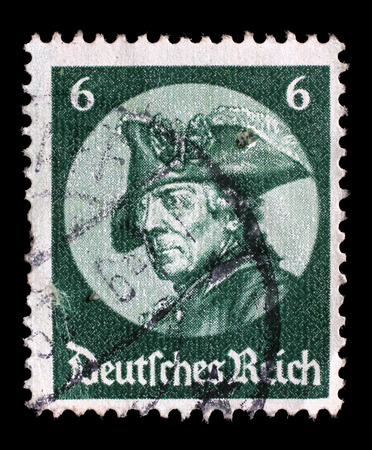 reigning: Stamp printed in the German Reich shows image of Friedrich der Grosse, third Hohenzollern king, reigning over the Kingdom of Prussia, series, circa 1933. Editorial