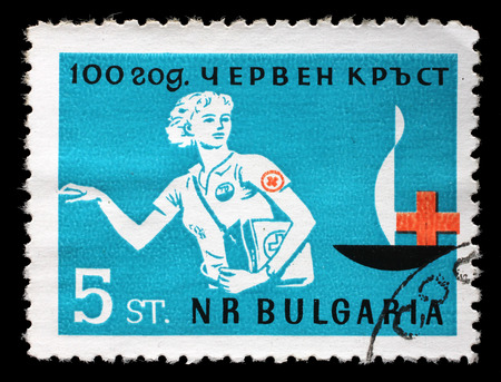 postmail: Stamp printed in Bulgaria devoted to 100 anniversary of the Red Cross shows a woman doctor, circa 1963