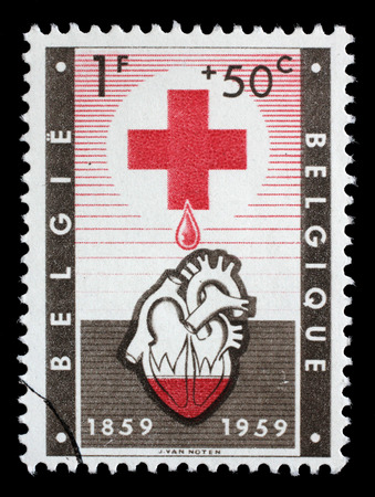 illustrating: Stamp from Belgium illustrating Red Cross, issued in 1959.
