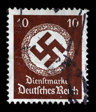 Reich: Stamp printed in Germany shows the Swastika in an oak wreath, circa 1942.
