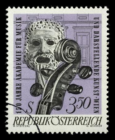 tragic: Stamp printed by Austria, shows Tragic Mask and Violin, circa 1967