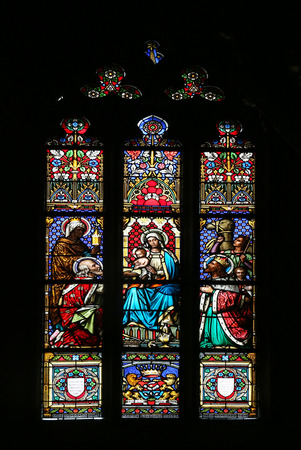 adoration: Nativity Scene, Adoration of the Magi, stained glass window in parish church of Saint Mark in Zagreb, Croatia