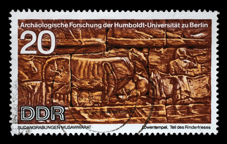 frieze: Stamp printed in GDR shows Sudanese Archaeological Excavations by Humboldt University Expedition, Part of the frieze Cattle, reproduce carvings unearthed at Lions Temple, Musawwarat, circa 1970