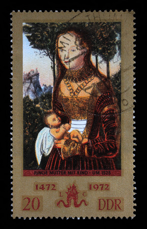 penance: Stamp printed in GDR from the Paintings issue shows Young mother with child (so called Penance of St. John Chrysostom) by Lucas Cranach the Elder, circa 1972. Editorial