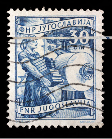 Stamp printed in Yugoslavia shows woman with books in publishing, domestic economy Series, circa 1952
