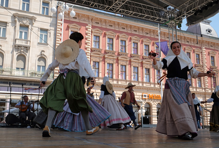 bot: Members of folk group Escola de ball de bot Calabruix from Mallorca, Spain during the 50th International Folklore Festival in center of Zagreb, Croatia on July 21, 2016