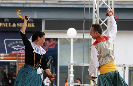 bot: Members of folk group Escola de ball de bot Calabruix from Mallorca, Spain during the 50th International Folklore Festival in center of Zagreb, Croatia on July 22, 2016