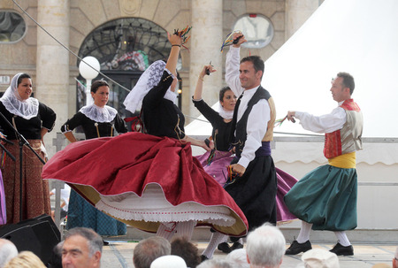 Members of folk group Escola de ball de bot Calabruix from Mallorca, Spain during the 50th International Folklore Festival in center of Zagreb, Croatia on July 22, 2016