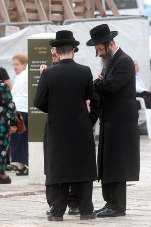 Jewish men pray at the western wall in Jerusalem, IL. The wall is one of the holiest sites in Judaism attracting thousands of worshipers daily. Editorial