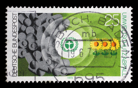 Stamp printed in the Germany shows Environment Emblem and Waste, Nature and Environmental Protection, circa 1973 Editorial